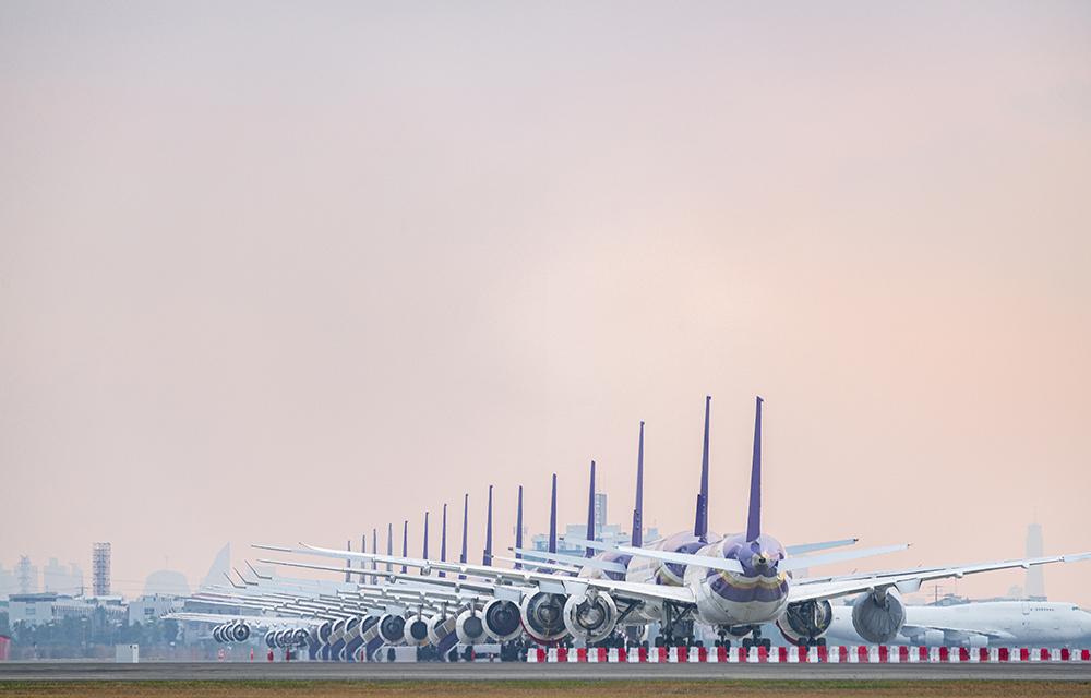Aircraft parking at airport runway because of COVID-19 pandemic