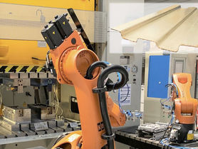 Economic production of hybrid components made of metal and FRP