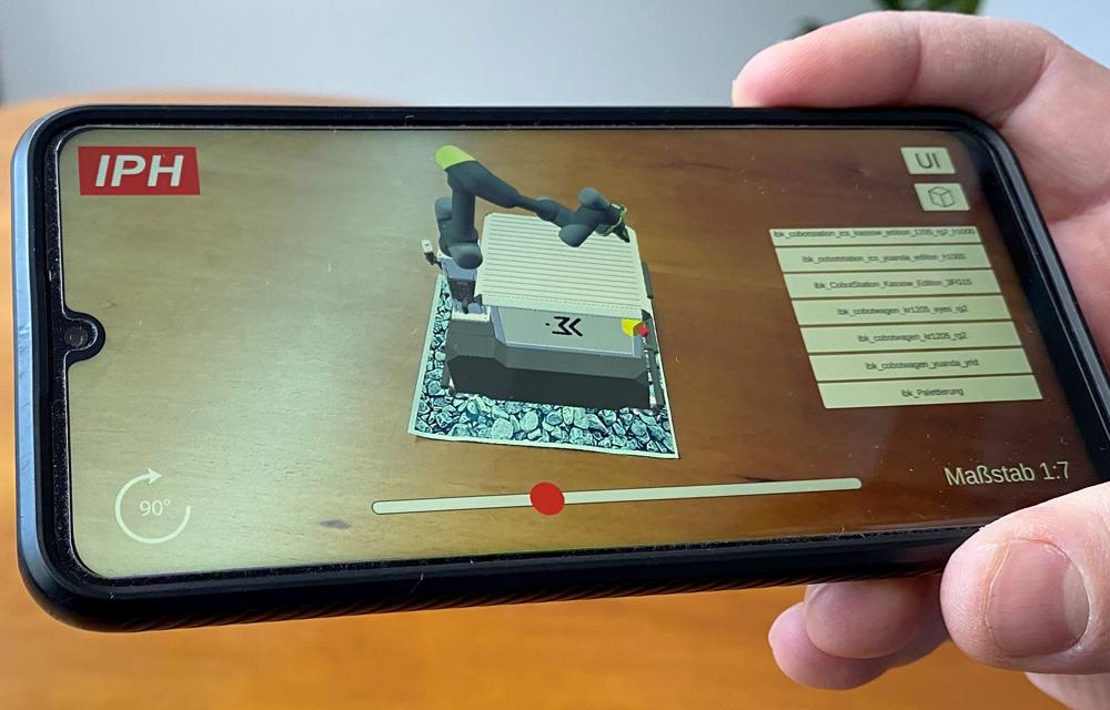 Maschinen und Anlagen lassen sich mit Augmented Reality in den Raum projizieren – skaliert wie auf dem Foto oder in Originalgröße. (Foto: IPH)